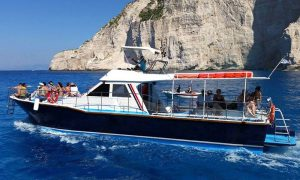 Boat leaving from Navagio Beach